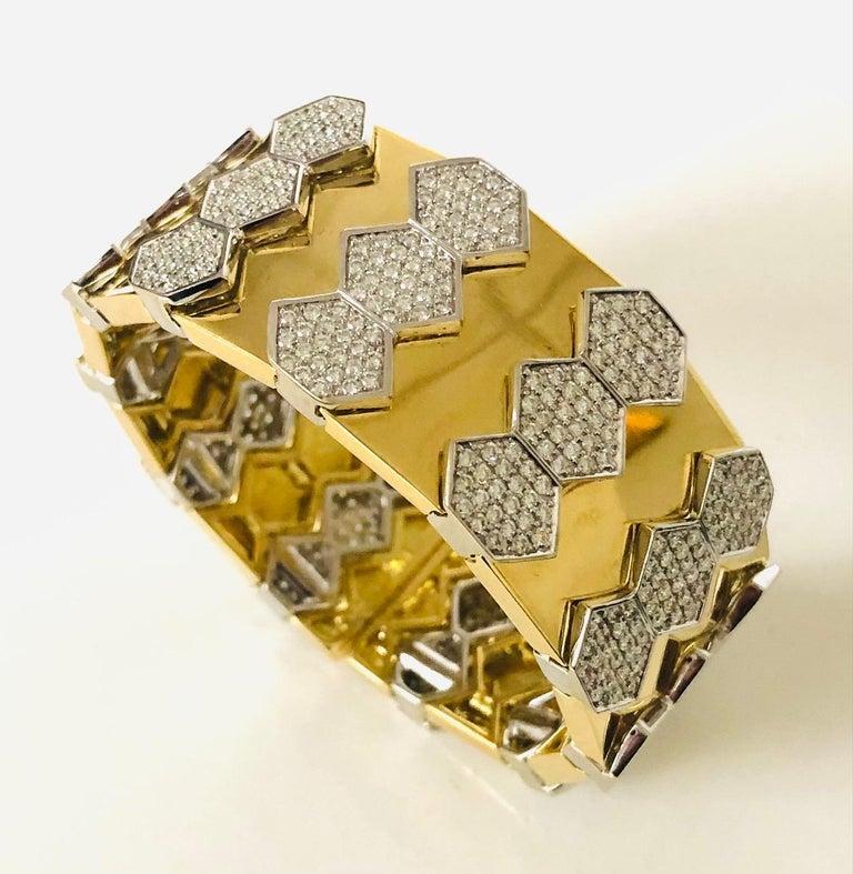 Contemporary 18 Karat Yellow and White Gold Diamond Spring Bangle Bracelet For Sale