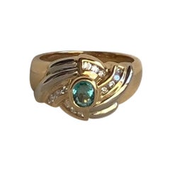 18k Yellow and White Gold with 0.40 Carat Emerald and 0.20 Carat Diamonds Ring