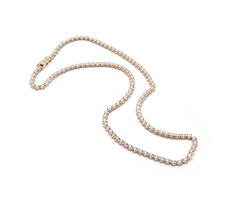 Designer: custom designed Material: 14k yellow gold Diamonds: round brilliant cut= 5.50cttw Color: I-J Clarity: SI Dimensions: necklace is 16.75-inches long and it is approximately 3.45mm wide Weight: 14.36 grams