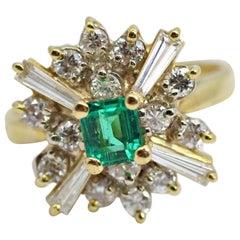 18 Karat Yellow Emerald and Diamond Ballerina Ring