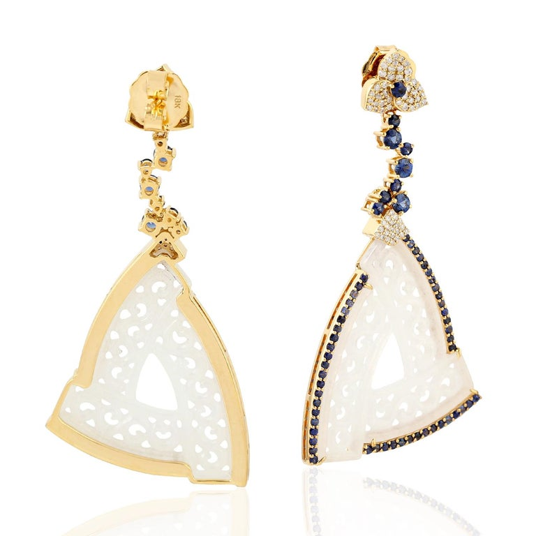 18k Yellow Gold 0.63ct Diamond 2.9ct Sapphire 27.5ct Jade Carving Dangle Earrings  2.9ct carats of Sapphire, jade carving, and Diamond set in 18k White Gold Dangle Earrings. The main highlighted part is the jade carving.  We guarantee all products