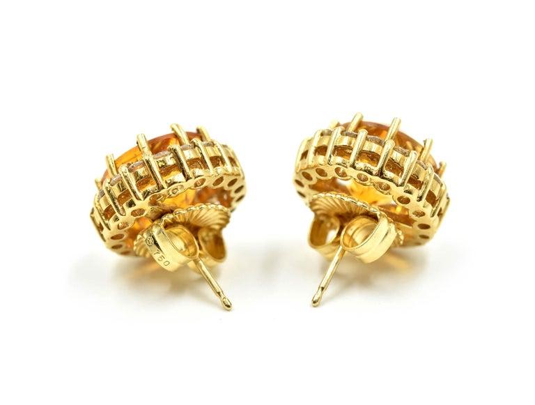Women's 18 Karat Gold, 4.00 Carat Fantasy Cut Citrine with Round Diamond Halo Earrings For Sale