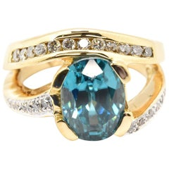 18k Yellow Gold 5.50ct Oval Blue Zircon and 0.40cttw Round Diamond Cocktail Ring