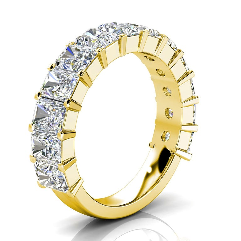 This Royalty ring features thirteen (13) Radiant Shape Diamonds Prong- Set approximately 1/2 a carat each on 3/4 of a 3.6 mm shank. It's a conversational piece! Experience the difference in person!  Product details:   Center Gemstone Type: NATURAL