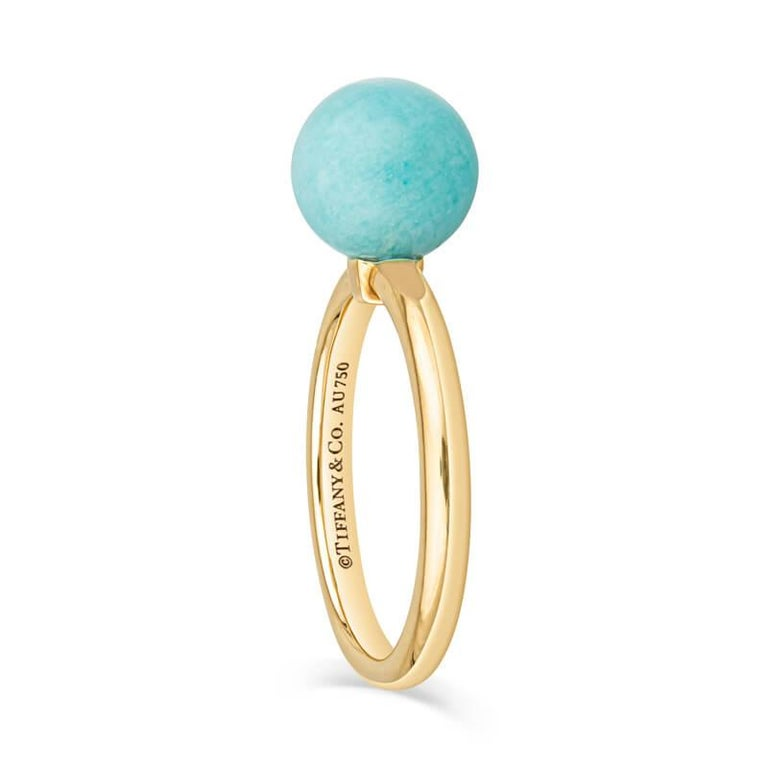 A beautiful and delicate ring featuring an 8mm Amazonite stone set in 18 karat yellow gold. Wear this ring alone or stack it with others! Please note this is a natural stone and some variations will occur. This ring is currently sized to a 4.5 but
