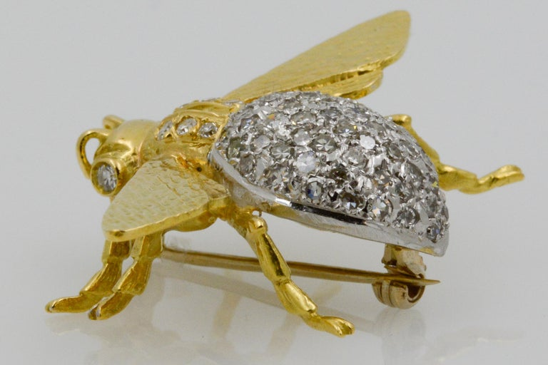 This charming 18k yellow gold fly pin features a pave diamond body with 80 single cut diamonds with a total combined weight of 1.35 carats GH SI.