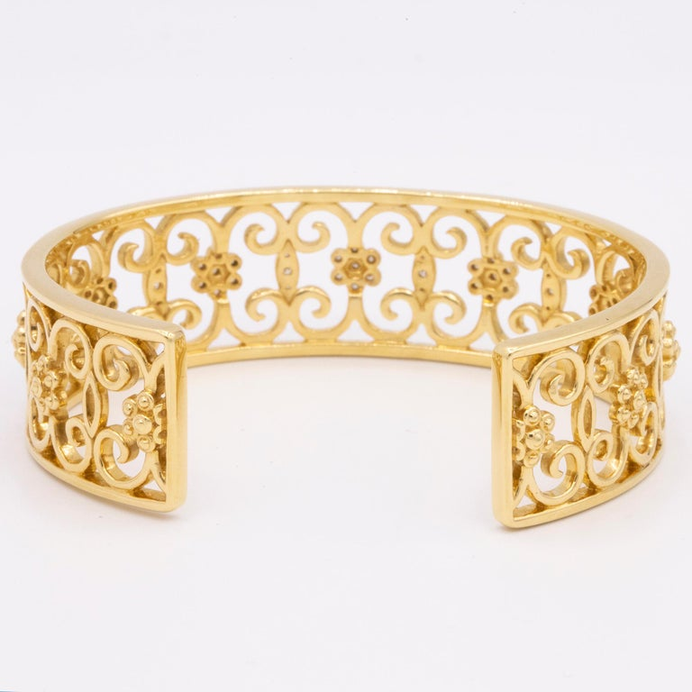 From Hamilton's Arabesque Collection, 18k yellow gold openwork cuff bracelet with 53 round brilliant diamonds, weighing .34ctw. This cuff is 17mm wide.