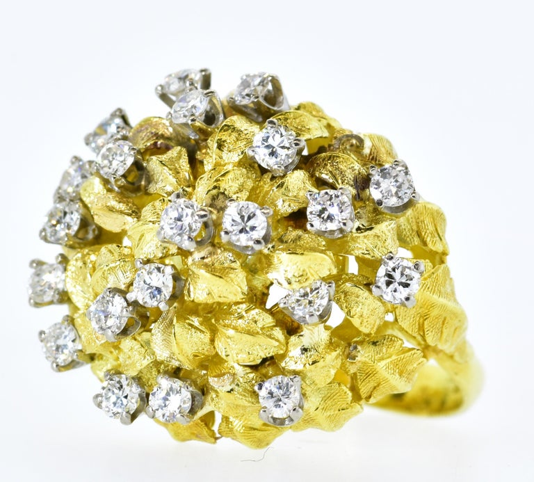 18K and diamond dome ring.  This ring, like the decade it represented, emulated abundance with more than 10 grams highly yellow gold and 21 modern round brilliant cut diamonds, set in white gold - all well cut and well matched and estimated to weigh