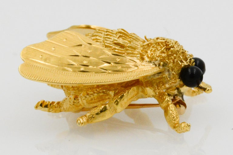 Modern 18 Karat Yellow Gold and Onyx Cellino Fly Pin For Sale
