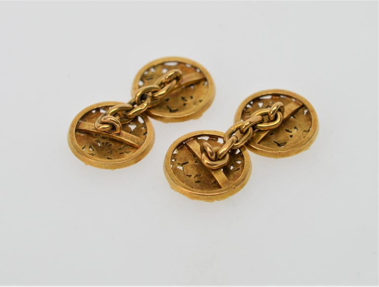 Antique English or Continental 18K Yellow Gold Cuff Links (pair) decorated with hand-applied Clover Leaves. Measuring  15mm Round, these Cuff Links are joined by a 3/4 inch 18K Yellow Gold Chain. Total weight 8.8 pennyweight 18K Gold. In Gift Box.