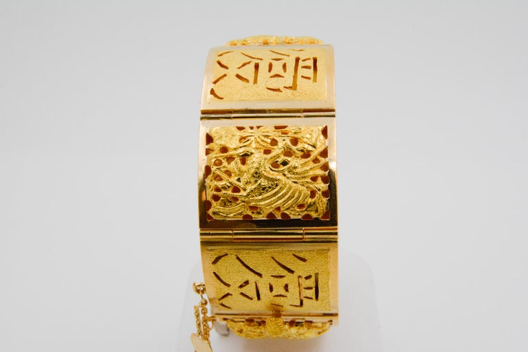 18 Karat Yellow Gold Asian Four Season Panel Bracelet In Good Condition For Sale In Dallas, TX