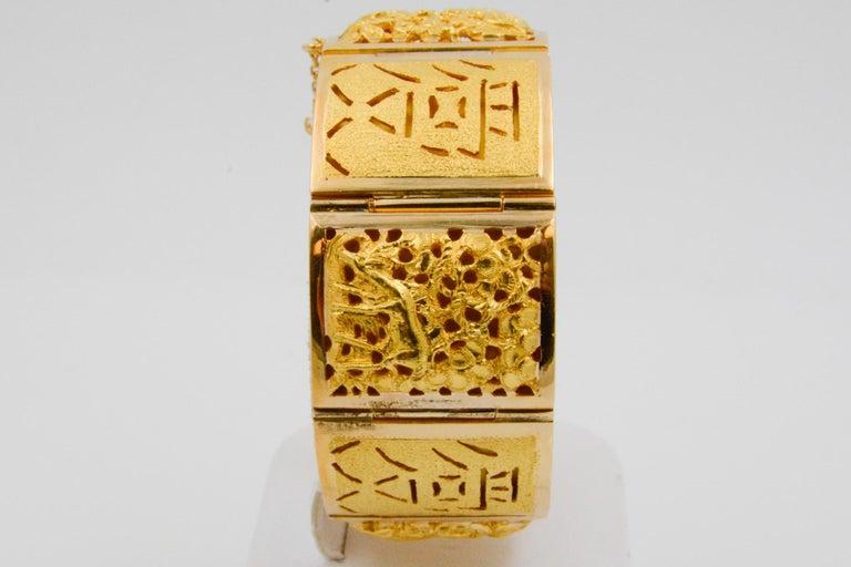 Women's 18 Karat Yellow Gold Asian Four Season Panel Bracelet For Sale