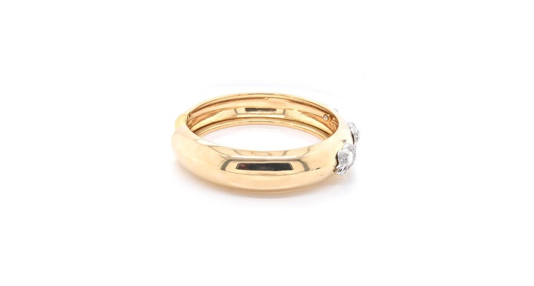 Material: 18k yellow gold Diamonds: 54 round brilliant cuts = 0.50cttw Color: G-H Clarity: SI1 Dimensions: bracelet measures 7-inches in length, 14mm in width Weight: 34.2 grams