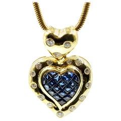 18 Karat Gold, Diamond and Blue Sapphire Heart Pendant on 14 Karat Snake Chain