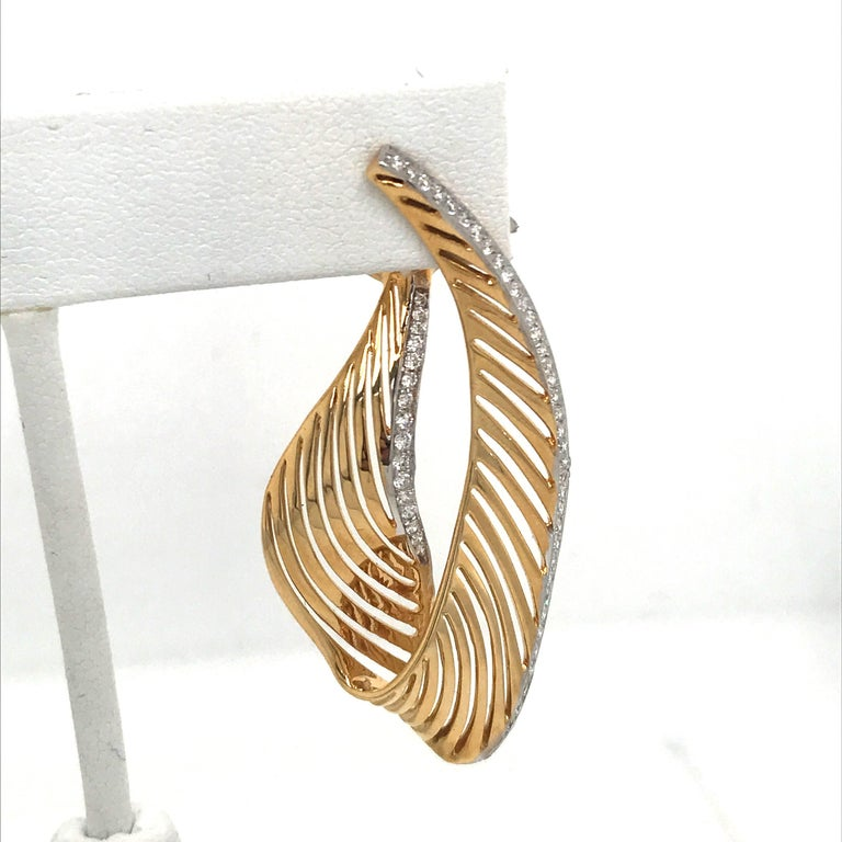 18K Yellow gold swirl drop earrings featuring 112 round brilliants weighing 1.03 carats.  Color H Clarity SI