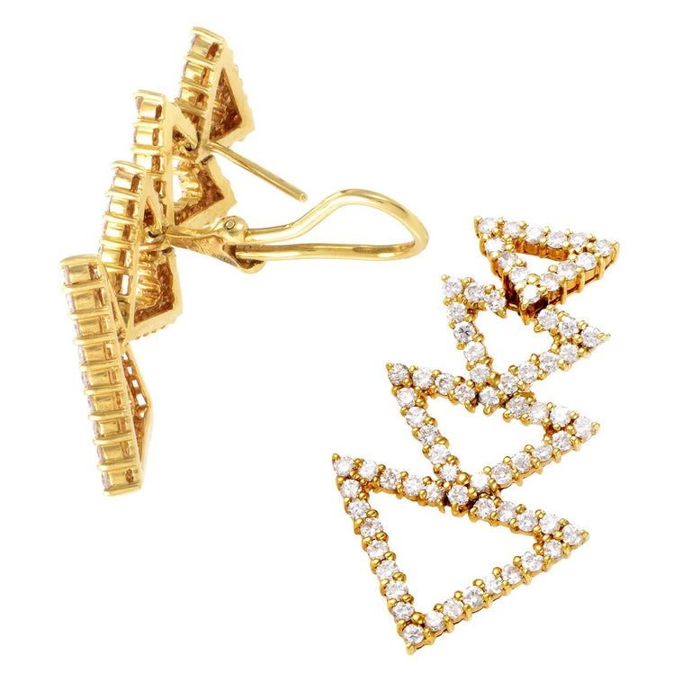 Employing the sheer glamorous appeal of the gorgeous blend of warm 18K yellow gold and luxurious sparkle of diamonds totaling 3.75 carats, these charming earrings boast a splendid arrangement of identical shapes for a strong sense of compelling