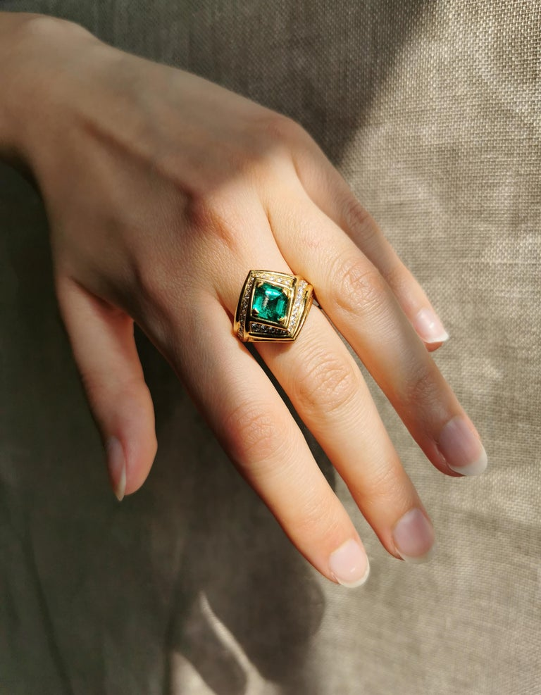 That 18K yellow gold ring set with a handsome emerald, emerald cut,  with a vivid intense green colour and with white diamonds. Circa 1980, created by Marion Jeantet Emerald weight: 1.23ct diamonds weight: 1.50ct This ring is a size 6 but can be