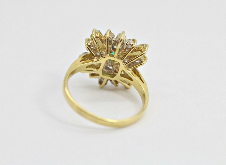 Contemporary 18k Yellow Gold Emerald and Diamond Ballerina Ring For Sale