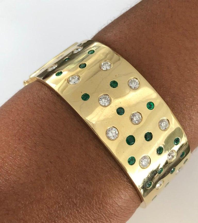 Women's 18 Karat Yellow Gold Emerald and Diamond Bangle Bracelet For Sale