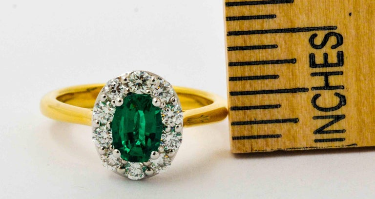 Modern 18 Karat Yellow Gold Emerald and Diamond Halo Engagement Ring For Sale