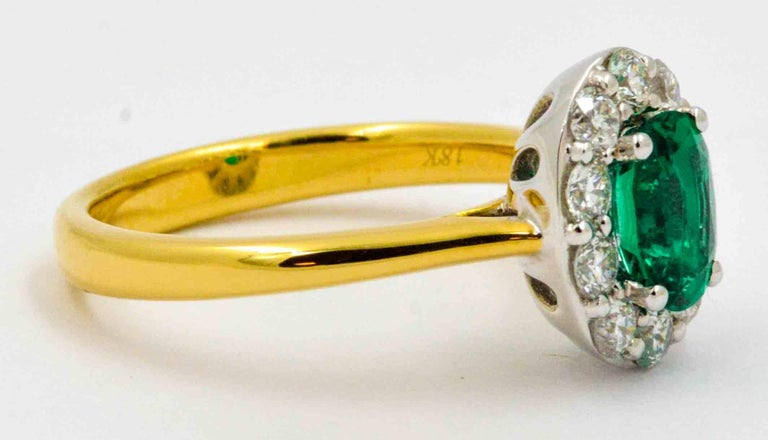 18 Karat Yellow Gold Emerald and Diamond Halo Engagement Ring For Sale 3