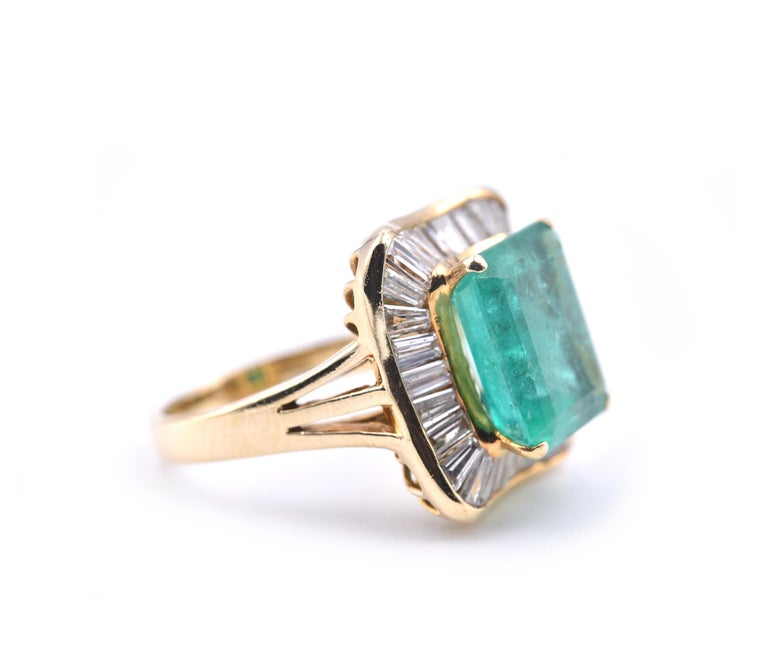 Designer: custom design Material: 18k yellow gold  Emerald: 4.41ct emerald Cut Diamonds: 29 baguette cut = .87cttw  Color: G Clarity: VS Ring Size: 6 (please allow two additional shipping days for sizing requests) Dimensions: ring top measures 17.12