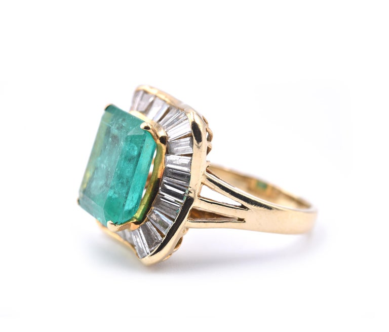 Round Cut 18 Karat Yellow Gold Emerald and Diamond Ring For Sale