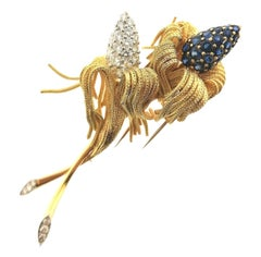 1960´s 18 Karats Yellow Gold Flowers Brooch with Diamonds and Sapphires