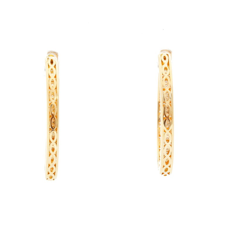 18K Yellow Gold Inside Out Pave Diamond Hoops  - 2.80 cts  of Pave diamonds on 18K Yellow Gold. They are the perfect earrings, they are light and do not bring your ear down. Perfect for every day .