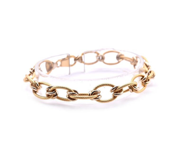 "18k Yellow Gold Italian Designed ""Creazioni"" Textured Oval Link Bracelet Designer: Creazioni Material: 18k yellow gold Dimensions: bracelet is 7.5-inches long and measures 9.70mm in width Weight: 8.87 grams"