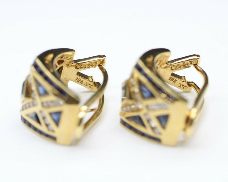 Authentic 18K yellow gold LeVian blue sapphire and diamond EARRINGS. This ring features 48 pieces princess cut and 12 pieces trilliant cut blue sapphire in approximately 1.85 carat total weight, and 56 round cut brilliant diamonds in approximately