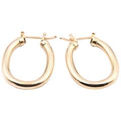 18 Karat Yellow Gold Oval Hoop Earrings