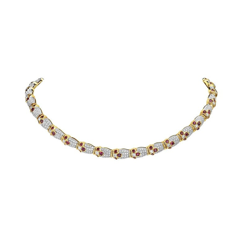 This choker features 8.11 carats of diamonds and 6.52 carats ruby set in 18K yellow gold. 63 grams total weight. 6 inch diameter. Made in Italy.  Viewings available in our NYC showroom by appointment.