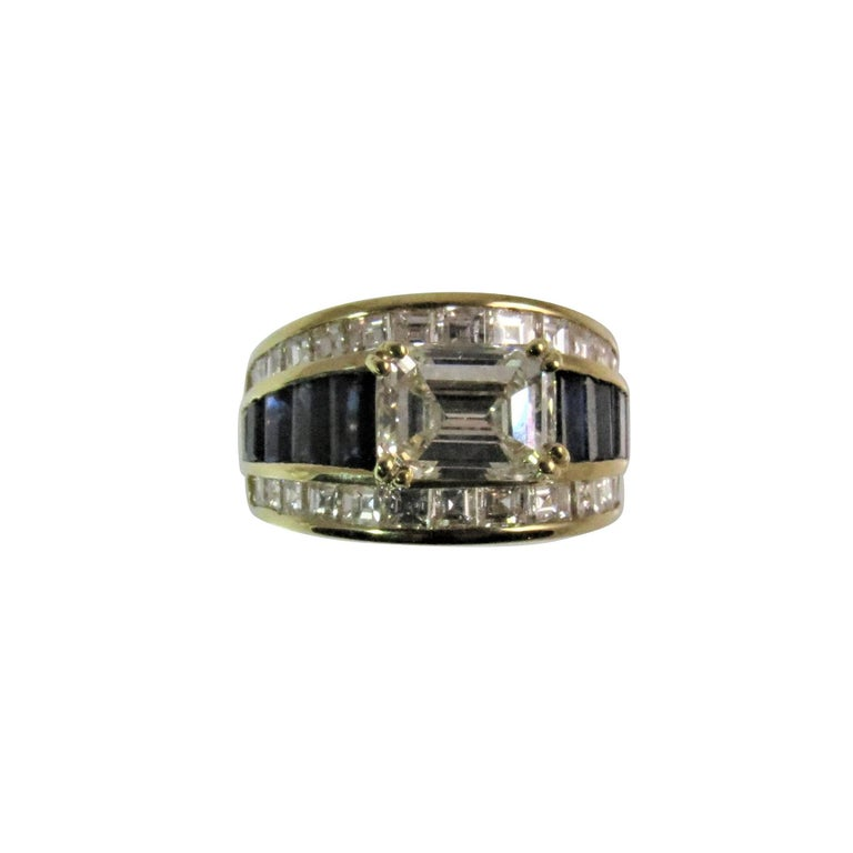 18K Yellow Gold Ring With 1.87ct Emerald Cut Diamond and Diamonds and Sapphires