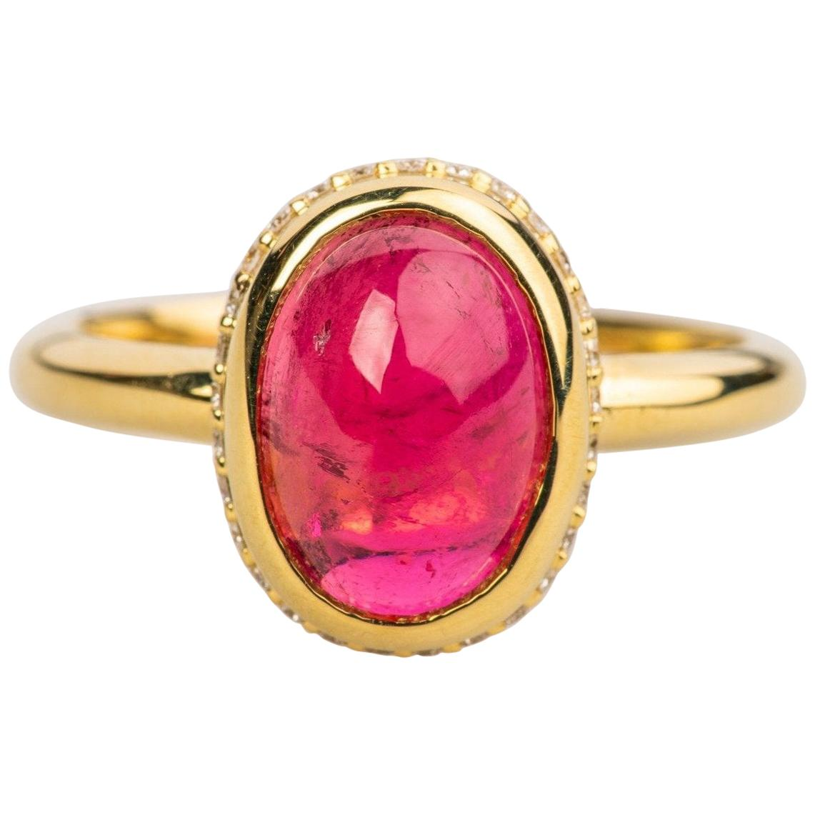18k Yellow Gold Ring with an Oval Red Tourmaline Cabochon and White Diamonds