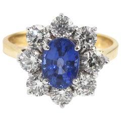 18 Karat Yellow Gold Sapphire and Diamond Cluster Ring