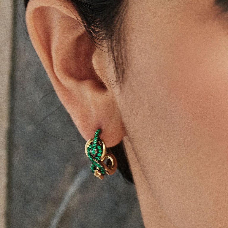 Earrings with Emeralds and rubies handcrafted in yellow gold and black rhodium-plated sterling silver in our signature SARPA Design.   Gemstones: Emeralds 0,55ct.; Rubies: 0,02ct. Material: Yellow Gold 750; Silver 925; Black Rhodium  These Earrings
