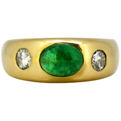 18k yellow gold unisex ring with an emerald of 1 carat & diamonds, Circa 1970's