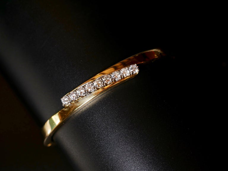 Modern 18 Karat Yellow Gold and White Round Brilliant Cut Diamond Bangle .90 Carat For Sale