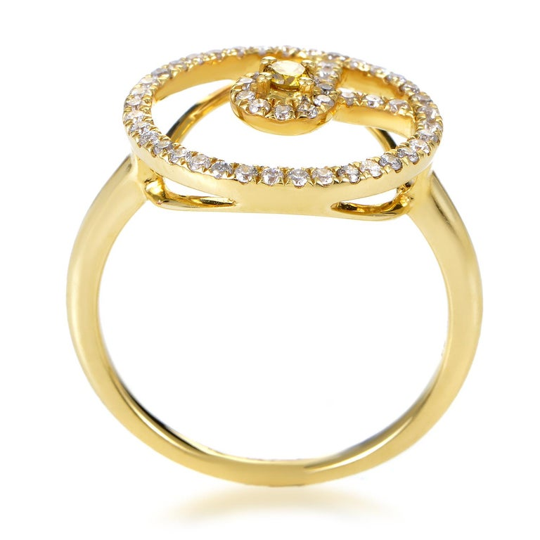 Marvelously interesting décor centers around a gorgeous yellow diamond in this enchanting 18K yellow gold ring, while lustrous white diamonds bring the total weight to 0.38ct and offer an eye-catching effect.<Br/>Ring Top Dimensions: 15 x 15mm