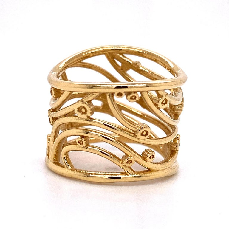 An 18k yellow gold wide ring inspired by the artwork of Gustav Klimt. Ring size 7. This ring was made and designed by llyn strong.