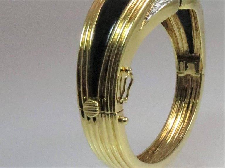 Contemporary 18 Karat Yellow Gold, Platinum Bracelet with Diamonds, Onyx and Ruby and Emerald For Sale