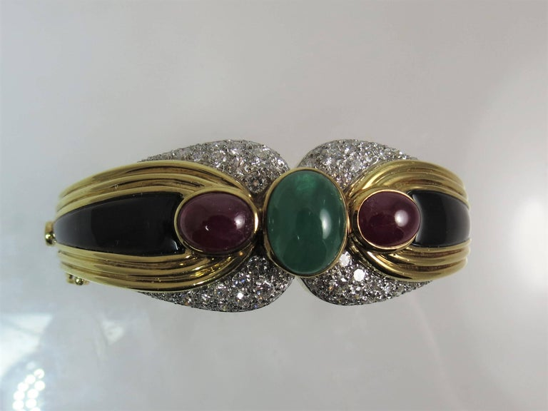 18 Karat Yellow Gold, Platinum Bracelet with Diamonds, Onyx and Ruby and Emerald In Excellent Condition For Sale In Chicago, IL