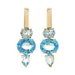 18Karat Yellow and White Gold Blue Topaz 0.16Karat White Diamond Dangle Earrings