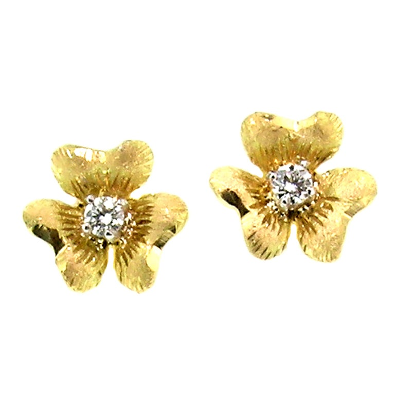 These sweet Floral stud earrings are hand engraved with a richly detailed Florentine finish.  They are a sculpted, three-dimensional shape that sits beautifully on the ear, and each is set with a high quality diamond (with a total weight of 0.06ct).