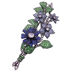 18Kt Blackened Gold Flower Brooch with Blue Sapphires, Tsavorites and Diamonds