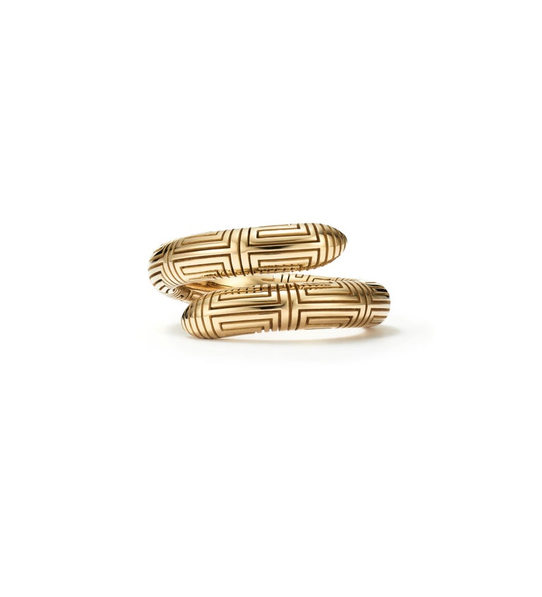The women and men of Ancient Greece wore this gold spiral ring that is delicately engraved by hand with the Grecian key pattern to represent the symbol of infinity. Wear it today effortlessly with jeans and a t-shirt.   Handcrafted with 18kt