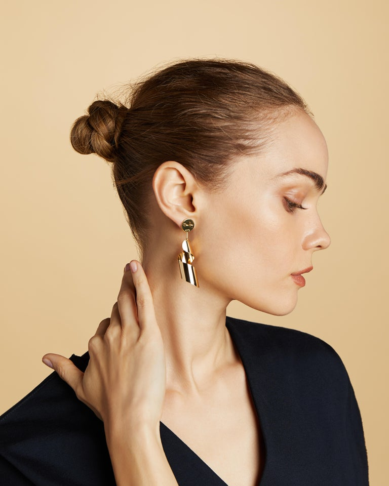 Designer: Man Ray  Artist Man Ray originally designed this lampshade motif back in the 1930s, but it wasn't until the 1970s that he re-designed them as earrings, a truly stunning work of art.  Handcrafted today in NYC with 18kt certified Fairmined