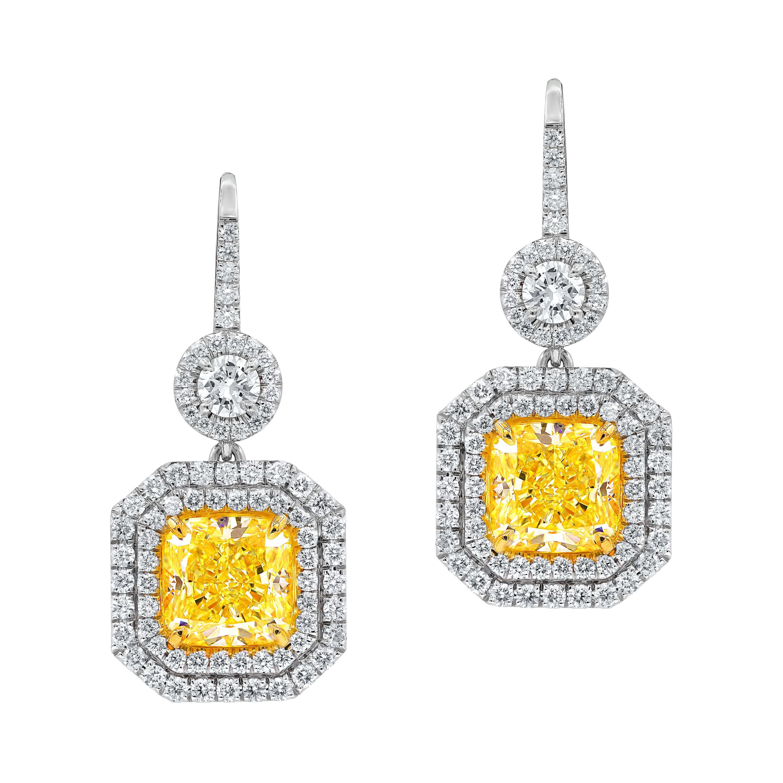 18kt Fancy Light GIA Certified Yellow Diamond Earring Set