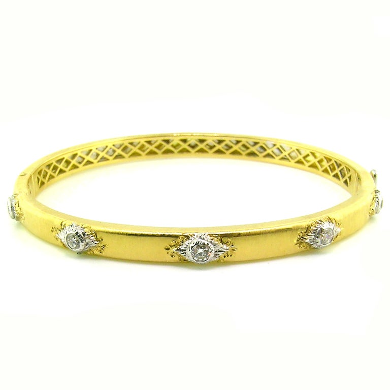 The Valentina Bangle is a classic staple for any jewelry wardrobe. Exquisitely executed details and fine diamonds (0.35ct) are framed in an oval bangle which is perfectly suited to everyday wear. This bangle is especially fantastic when stacked in